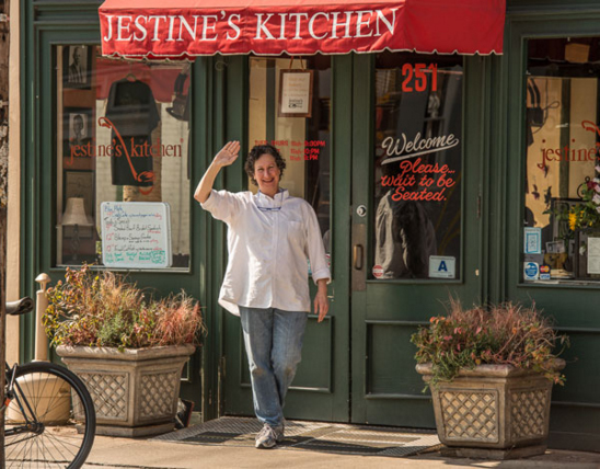 Owner, Dana Strange, in front of Jestine's Kitchen.